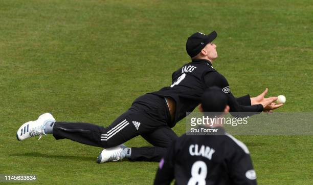 Surrey fielder Will Jacks dives to complete the catch to dismiss Glamorgan batsman Graham Wagg during the Royal London One Day Cup match between...