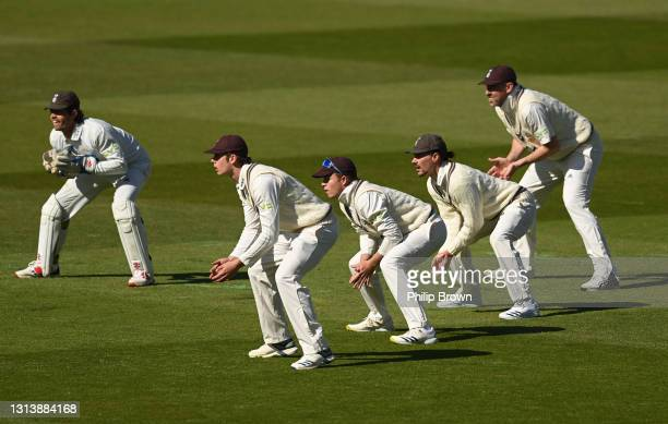 Surrey fielders including Ben Foakes, Ollie Pope, Rory Burns and Rikki Clarke ready themselves during day one of the LV= Insurance County...