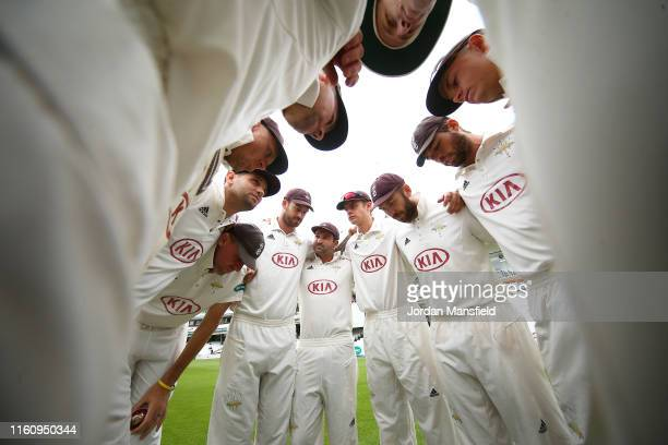 Surrey huddle prior to the start of play on day three the Specsavers County Championship Division 1 match between Surrey and Kent at The Kia Oval on...