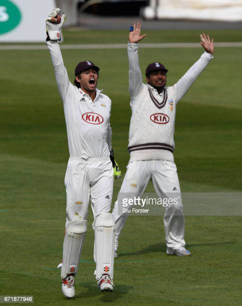 Surrey keeper Ben Foakes and slip Kumar Sangakkara appeal for a catch during day three of the Specsavers County Championship Division One between...