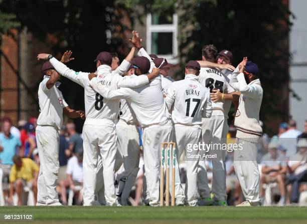 Surrey players celebrate after beating Somerset by an innings and 69 runs during day 3 of the Specsavers County Championship Division One match...