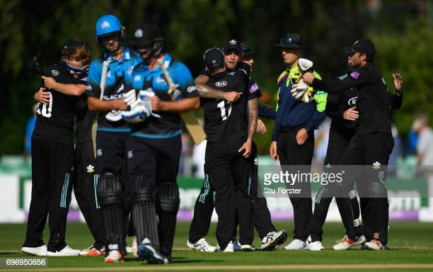 Surrey players celebrate as Worcestershire batsmen Josh Tongue and Ross Whiteley leave the field after the Royal London OneDay Cup Semi Final between...