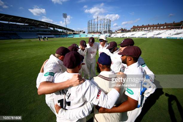 Surrey players huddle during day three of the Specsavers County Championship Division One match between Surrey and Lancashire at The Kia Oval on...