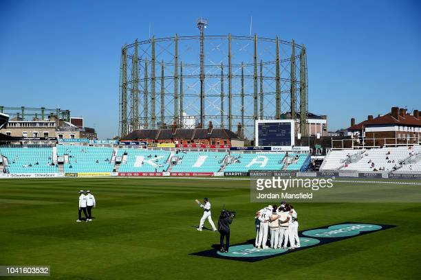 Surrey players huddle prior to opening the fielding during day three of the Specsavers County Championship Division One match between Surrey and...