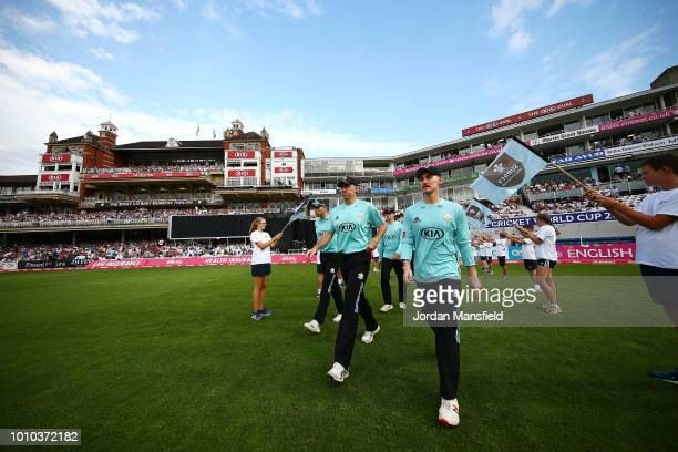 Surrey players make their way to the field to open the fielding during the Vitality Blast match between Surrey and Middlesex at The Kia Oval on...