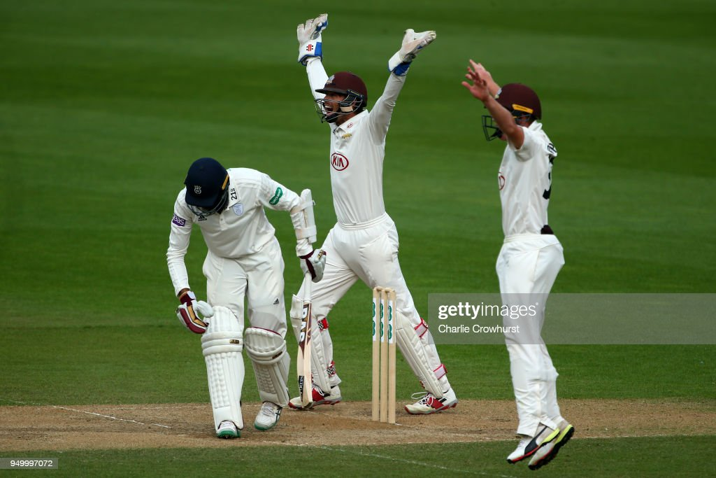 Surrey wicket keeper Ben Foakes and Ollie Pope appeal as Hampshire's Hashim Amla is given out for LBW during day three of the Specsavers County Championship Division One match at The Kia Oval on April 22, 2018 in London, England.