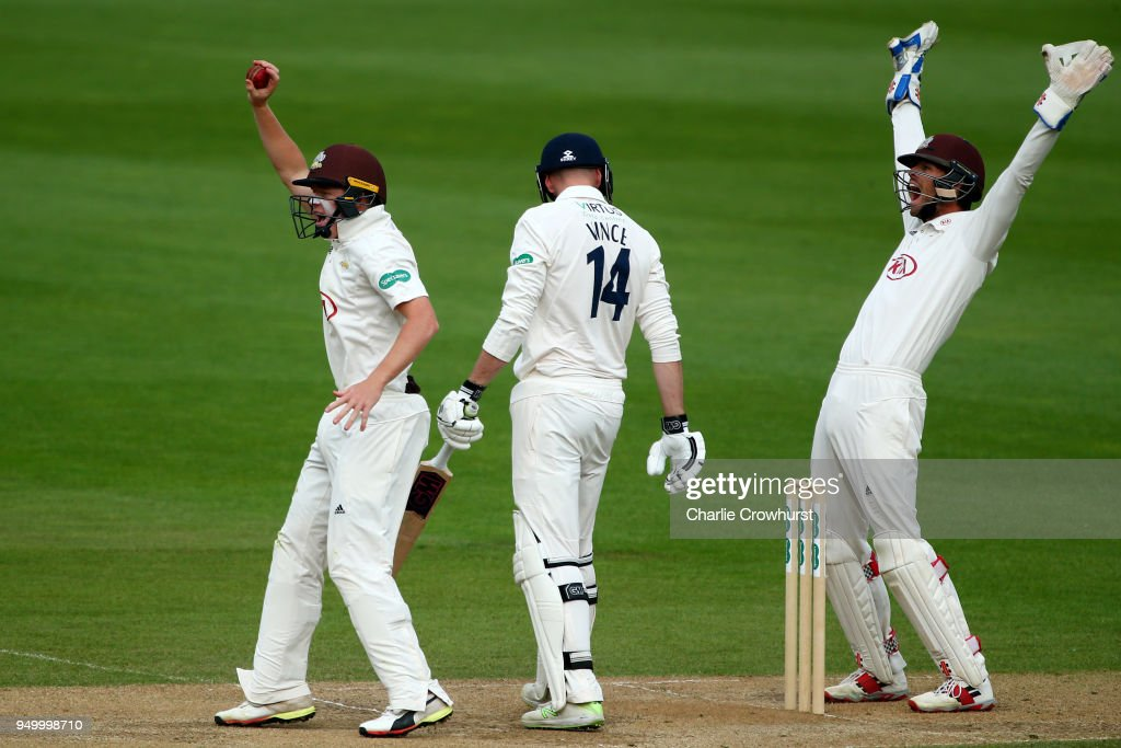 Surrey wicket keeper Ben Foakes and Ollie Pope appeal as Hampshire's James Vince is given out for LBW during day three of the Specsavers County Championship Division One match at The Kia Oval on April 22, 2018 in London, England.