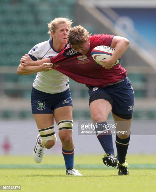 Surrey's Alice Soper hands off Yorkshire's Kat Hobson during the Gill Burns Division 1 Final at Twickenham Stadium London