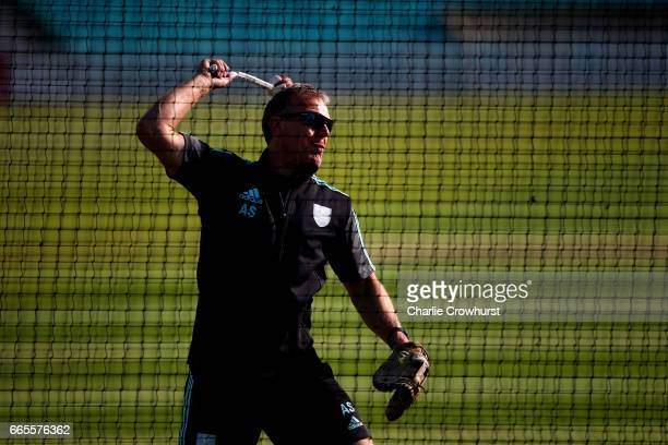 Surrey's Assistant head coach Alec Stewart warms players up in the net ahead of the Specsavers County Championship Division One match between Surrey...
