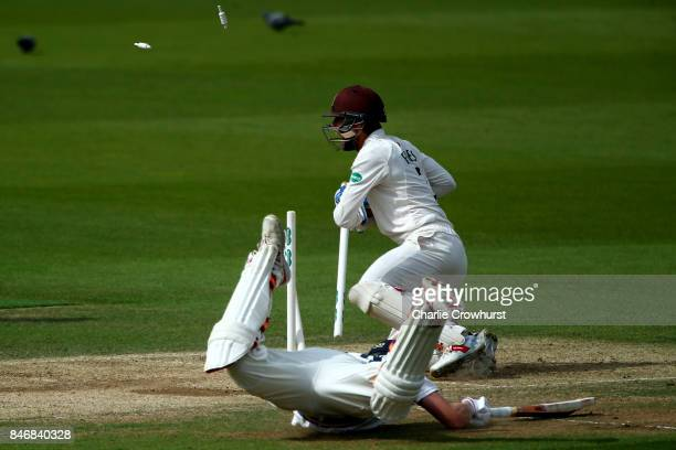 Surrey's Ben Foakes smashes the stumps as Yorkshire's Gary Balance is run out during day three of the Specsavers County Championship Division One...