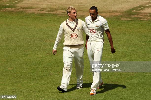 Surrey's captain Rory HamiltonBrown talks to bowler George Edwards