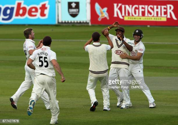 Surrey's Chris Jordan celebrates catching Derbyshire's Ross Whiteley with team mates
