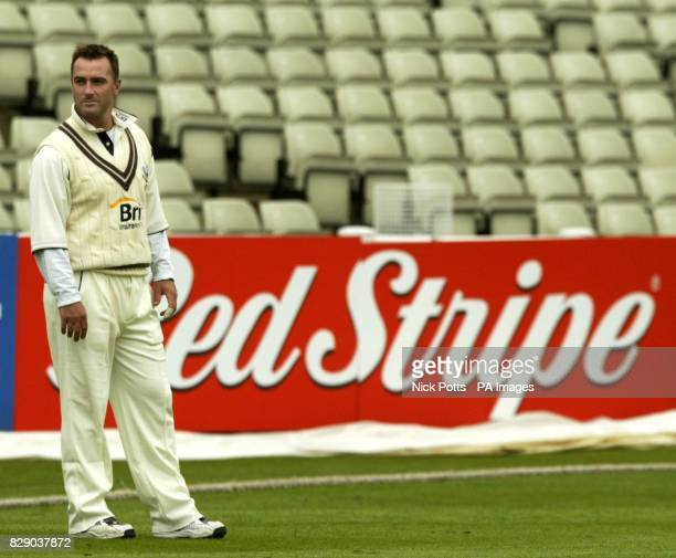 Surrey's Graham Thorpe fields on the lonely boundary at Edgbaston in Birmingham during his first County Championship game since returning from...