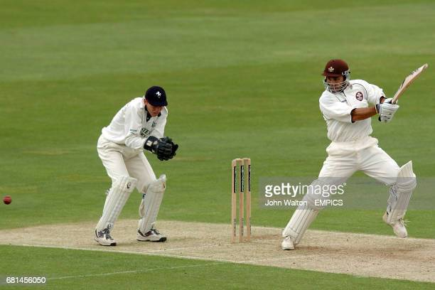 Surrey's Mark Ramprakash smashes the ball past Kent's wicketkeeper Niall O'Brien on his way to making 50 before lunch