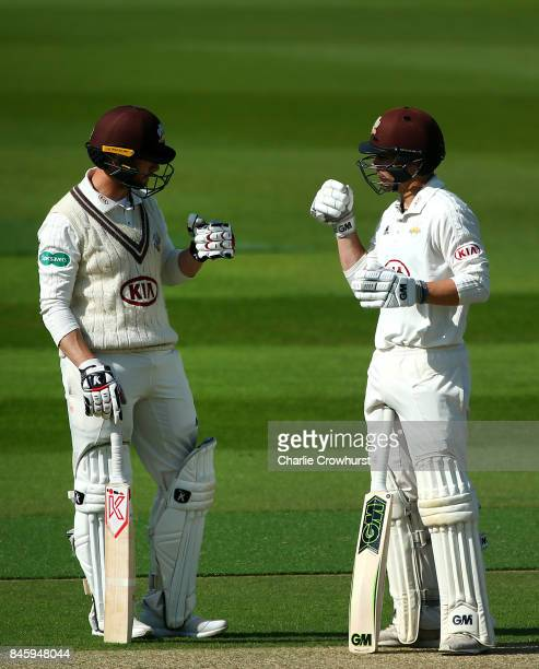 Surrey's Mark Stoneman and Rory Burns chat in the middle during day one of the Specsavers County Championship Division One match between Surrey and...