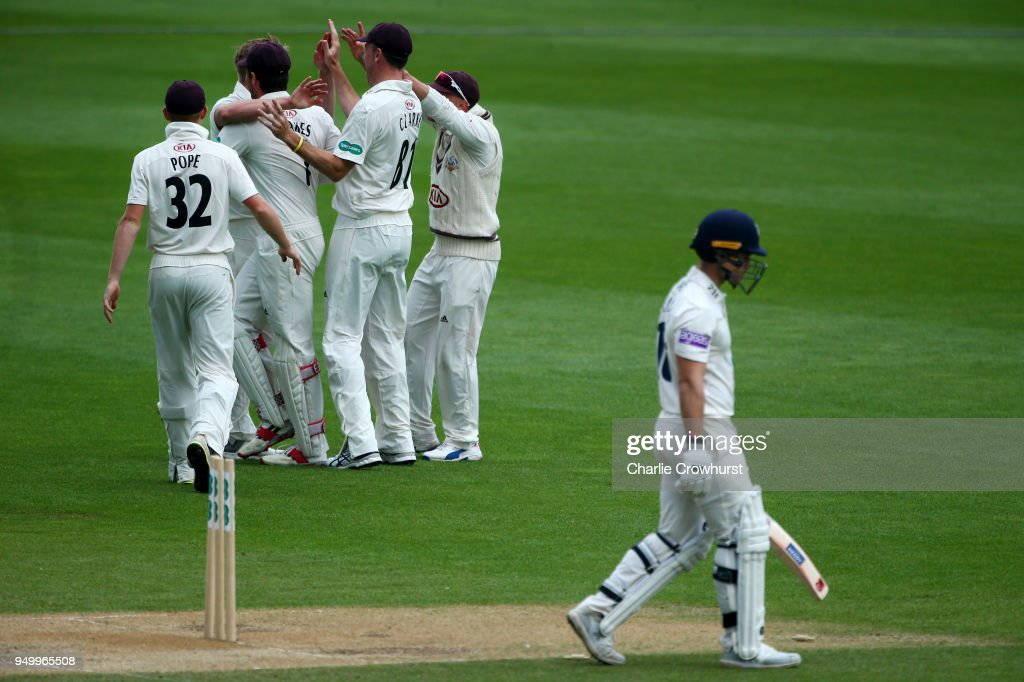 Surrey's Matt Dunn celebrates with team mates after taking the wicket of Hampshire's Lewis McManus during day three of the Specsavers County Championship Division One match at The Kia Oval on April 22, 2018 in London, England.