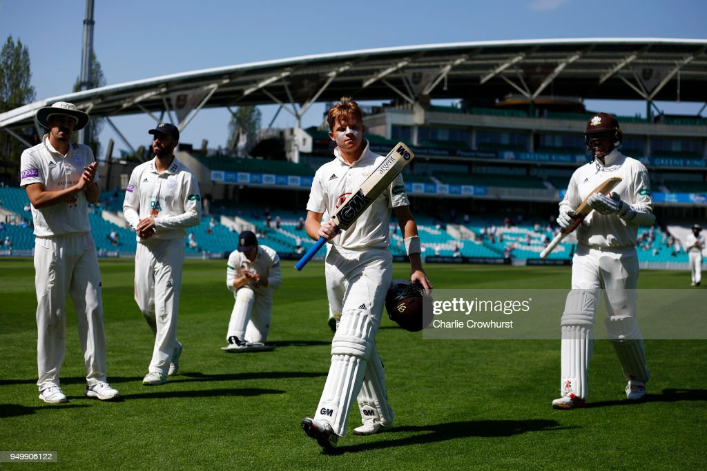 Surrey's Ollie Pope is applauded off the pitch at lunch after making a century during day three of the Specsavers County Championship Division One match at The Kia Oval on April 22, 2018 in London, England.