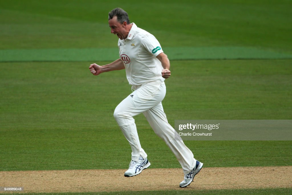 Surrey's Rikki Clarke celebrates after taking the wicket of Hampshire's Jimmy Adams during day three of the Specsavers County Championship Division One match at The Kia Oval on April 22, 2018 in London, England.