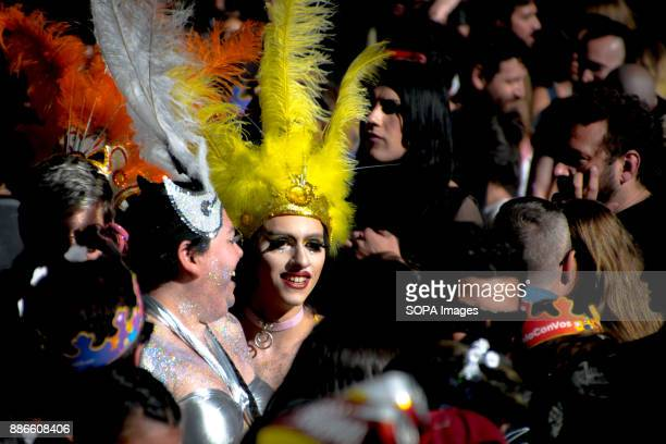 Surrounded by a sea of people two fabulous feathered queens smile at supporters Thousands of pride supporters marched from Plaza de Mayo to Congreso...