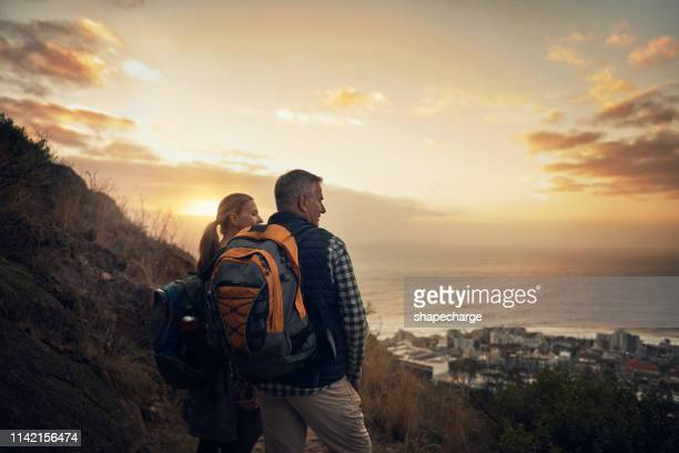 surrounded by an expanse of spectacular scenery - twilight stock pictures, royalty-free photos & images