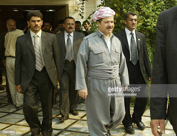 Surrounded by body guards the leader of the Kurdistan Democratic Party Massoud Barzani leaves a hotel in the Iraqi Kurdish town of Salahuddin some...