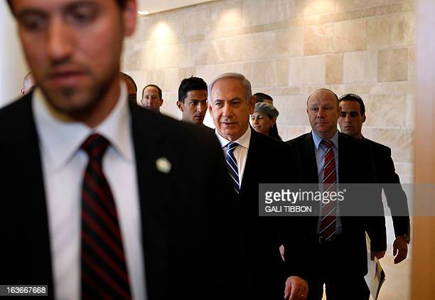 Surrounded by bodyguards Israeli Prime Minister Benjamin Netanyahu arrives to the LikudBeiteinu faction meeting at the Knesset on March 14 2013 in...