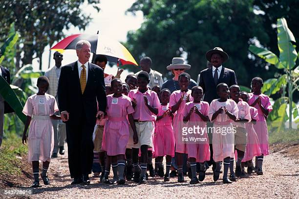 Surrounded by children American President Bill Clinton and wife Hillary are welcomed by President of Uganda General Yoweri Kaguta Museveni