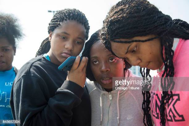Surrounded by family and friends Leonore Harris listens to a Facebook Live video that she believes pertains to the death of her sister Kenneka...