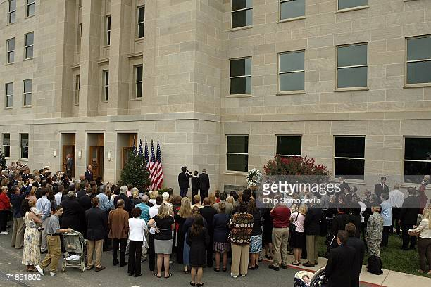 Surrounded by family members and friends of the victims of the September 11 2001 attack on the Pentagon United States President George W Bush and...