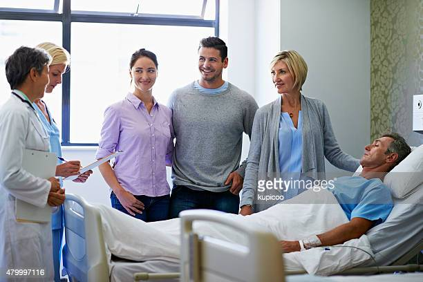 surrounded by family - patients brothers stock pictures, royalty-free photos & images
