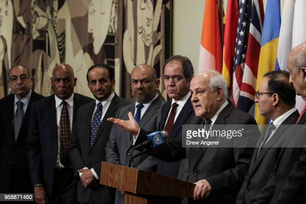 Surrounded by fellow Arab ambassadors to the United Nations, Permanent Observer of Palestine to the United Nations Riyad Mansour speaks during a...