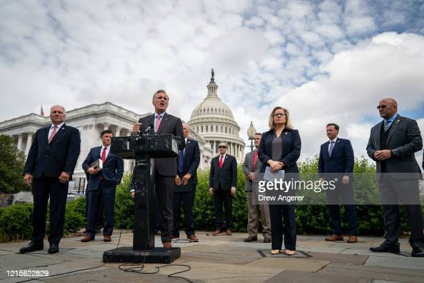 Surrounded by fellow House Republican members, House Minority Leader Rep. Kevin McCarthy speaks during a news conference outside the U.S. Capitol,...