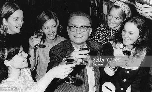 Surrounded by female members of his staff, Prof. Paul Samuelson offers a toast after he was named the winner of the 1970 Nobel Prize for Economics....
