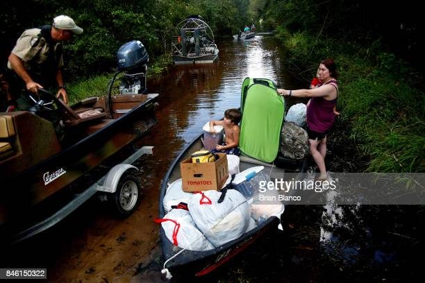 Surrounded by floodwater from the nearby Peace River Robyn Barber waits in the boat with her two children her cats and everything they could salvage...