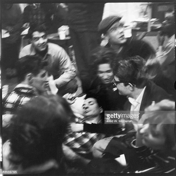 Surrounded by groupies American author Jack Kerouac lies down during a break in poetry reading at the Artist's Studio New York New York February 15...