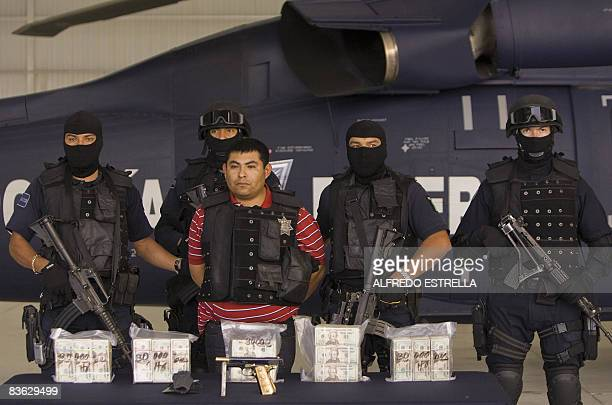 "Surrounded by heavily armed police officers, Jaime Gonzalez Duran, a.k.a. ""Hummer"", founder of a group of hitmen called the ""Zetas"", is shown to the..."