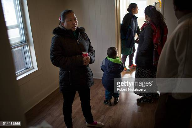 Surrounded by her relatives Tika Gurung looks for a new apartment Burlington Vermont December 10 2015 Members of the extended Gurung family moved to...