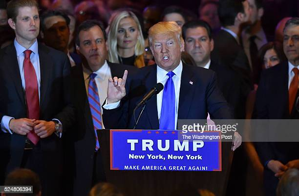 Surrounded by his supporters, Republican presidential candidate Donald Trump addresses the media at Trump Tower following primary election results on...