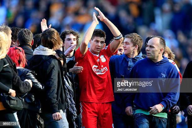 Surrounded by Hull City fans who have invaded the pitch at fulltime Steven Gerrard of Liverpool makes his way to the away fans to applaud them during...