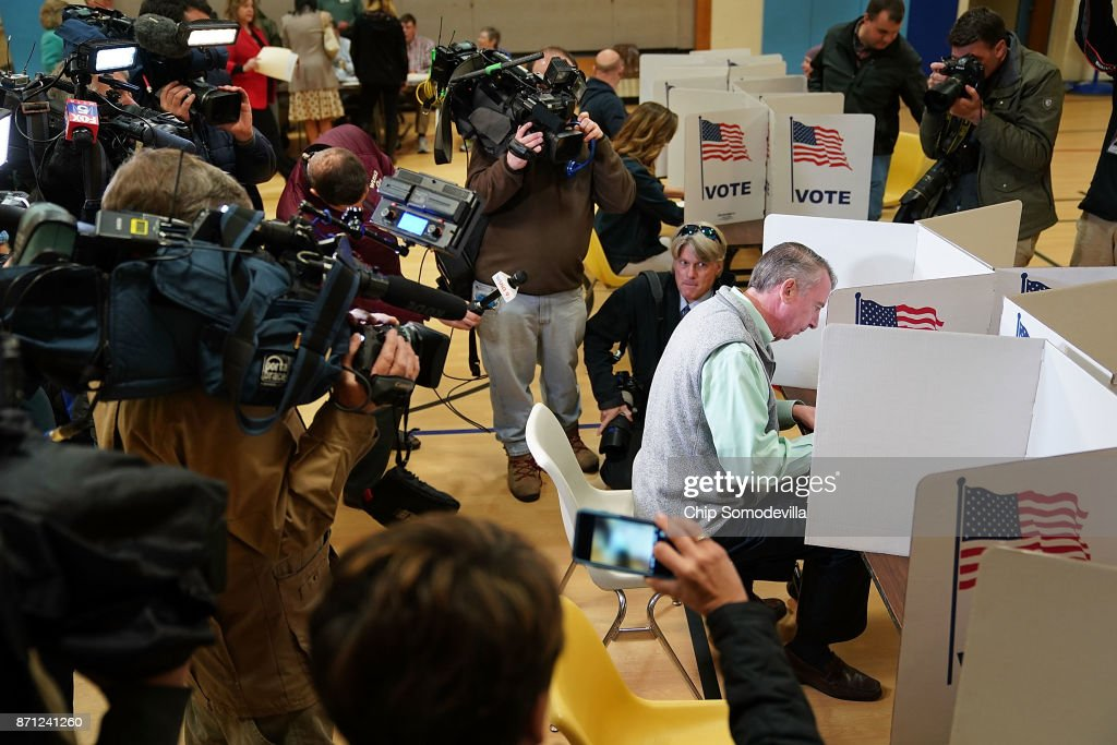 Surrounded by journalists, Republican candidate for Virginia governor Ed Gillespie fills out his ballot in the gymnasium at Washington Mill Elementary School November 7, 2017 in Alexandria, Virginia. In a race that many see as a test of the Republican administration of President Donald Trump, Gillespie is running against the commonwealth's current lieutenant governor, Democrat Ralph Northam.