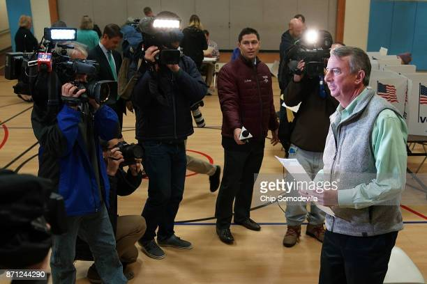 Surrounded by journalists Republican candidate for Virginia governor Ed Gillespie casts his vote in the gymnasium at Washington Mill Elementary...