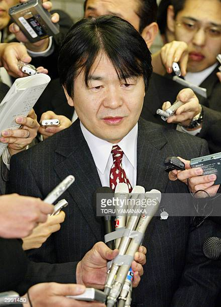 Surrounded by journalists State minister for Economic and Fiscal Policy Heizo Takenaka answers questions in Tokyo 18 February 2004 just after the...