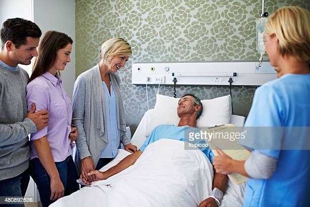 surrounded by loved ones - patients brothers stock pictures, royalty-free photos & images