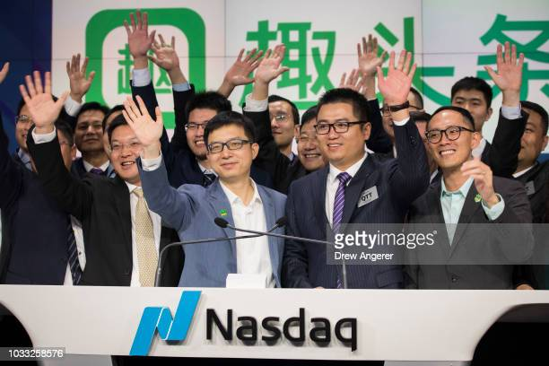 Surrounded by management and executives Eric Siliang Tan Chairman and CEO of Qutoutiao celebrate after ringing the closing bell at Nasdaq MarketSite...