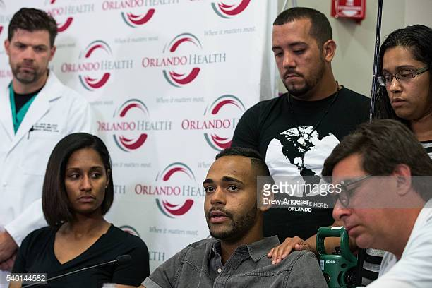 Surrounded by medical personnel and his siblings Angel Colon who was injured in the Pulse Nightclub shooting speaks to the media during a press...