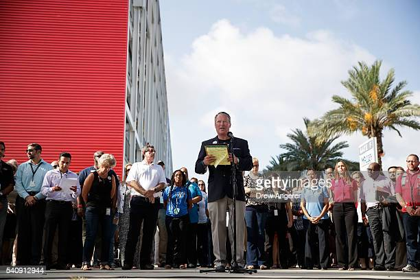 Surrounded by members of federal, state and local agencies, Orlando Mayor Buddy Dyer speaks at a press conference to provide an update on the...