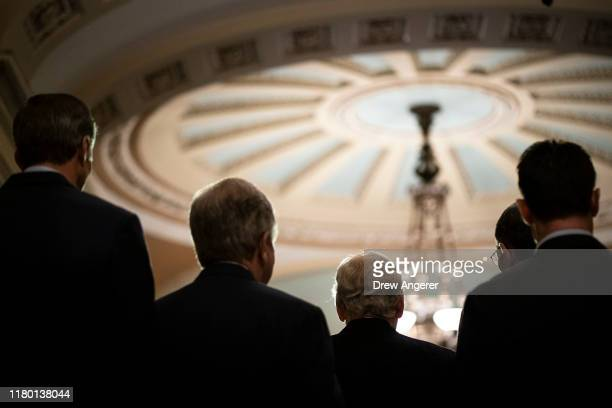 Surrounded by members of the Senate GOP caucus Senate Majority Leader Mitch McConnell speaks to reporters following the weekly Republican policy...