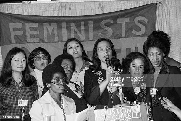 Surrounded by minority women at the Houston Civic Center Coretta Scott King talks of the resolution on minority women's rights that won the support...