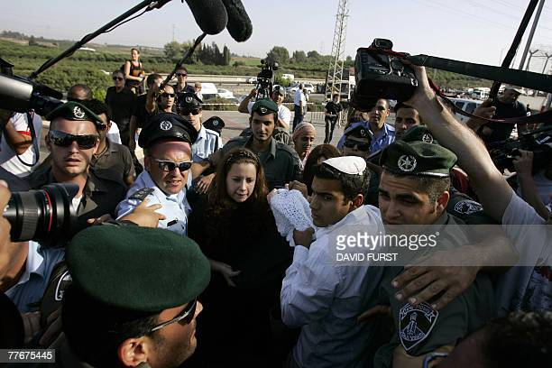 Surrounded by news media the wife and family members of Israeli assassin Yigal Amir carry Amir's newborn son into the Hasharon Prison for...