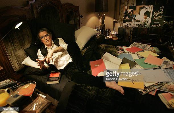 Surrounded by numerous scripts books and magazines put there for a photo shoot former Paramount Studios head producer actor racanteur and Hollywood...